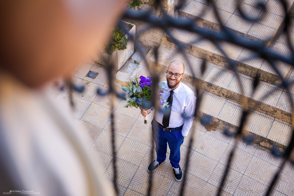 wedding-photography-groom-flowers-blessing-photography