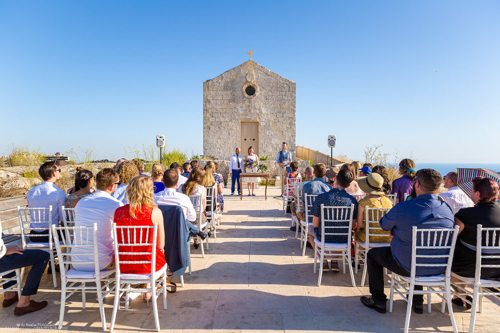 Wedding blessing in front of Dingli chapel, Malta. North East wedding photographer.