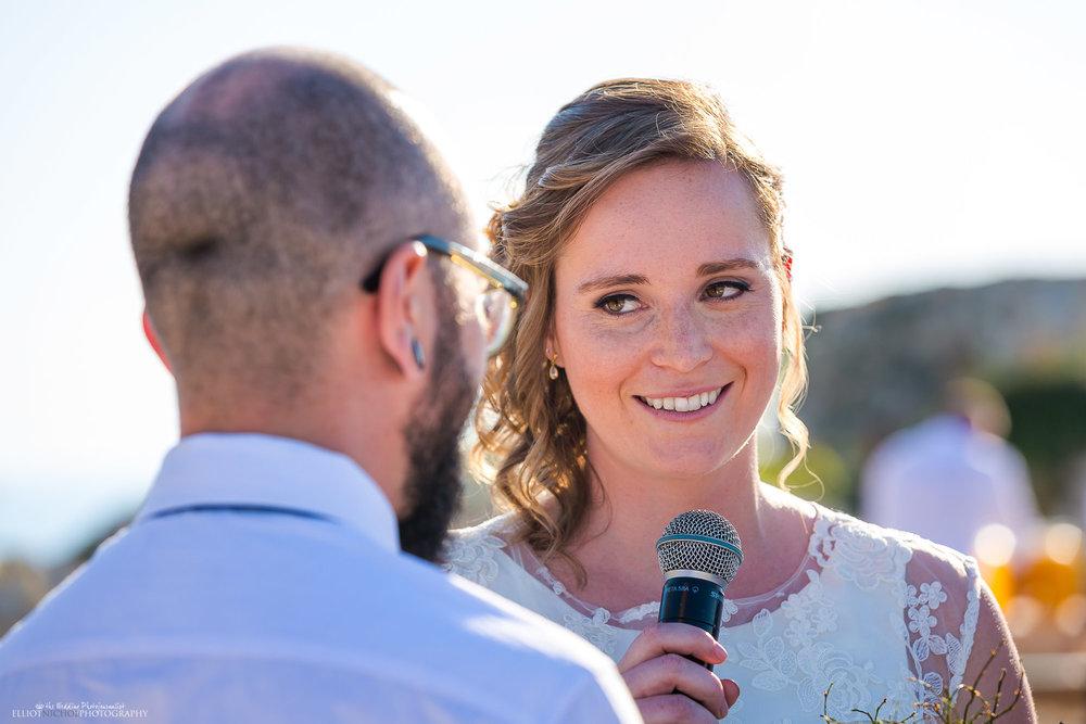 Destination bride reading her wedding vows to her Groom. Elliot Nichol Photography.