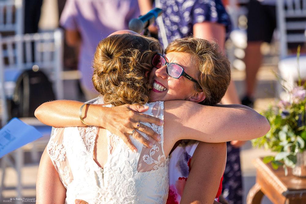mother-bride-hug-wedding-ceremony-photography