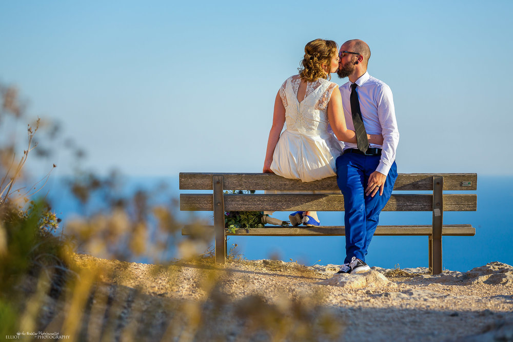 bride and groom kissing after their wedding blessing on Dingli Cliffs in Malta. Elliot Nichol Photography.