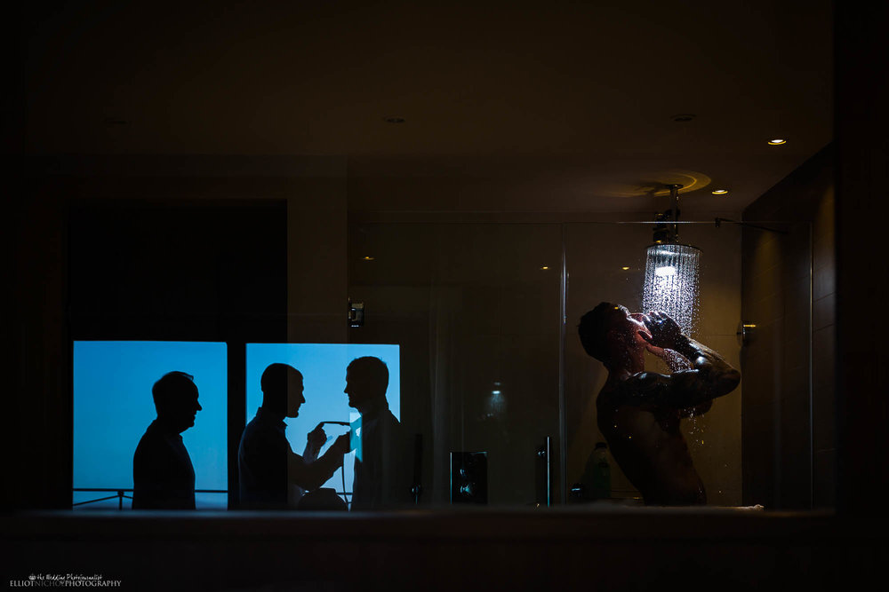 Showering Groom from Bexleyheath in Kent getting ready with his Groomsmen on his wedding day. Newcastle Upon Tyne based wedding photographer Elliot Nichol.