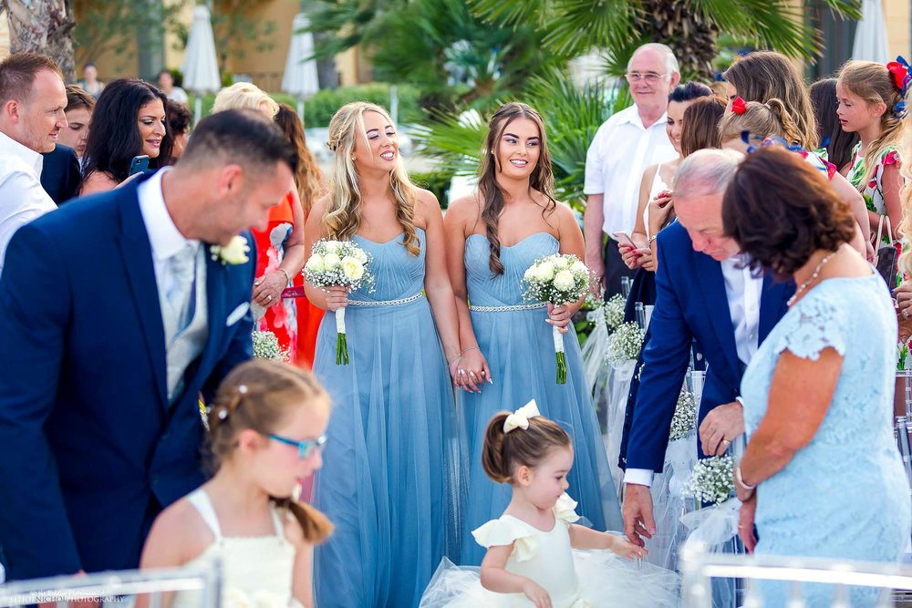 Bridesmaids arrive at the wedding ceremony in their blue bridesmaid dresses. Northeast wedding photography.