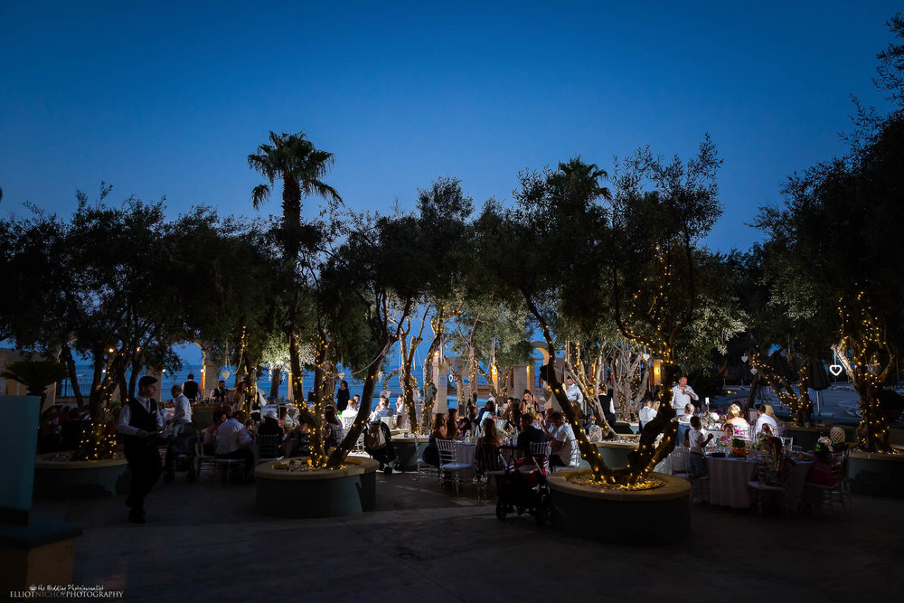 destination wedding's reception setup under olive trees.