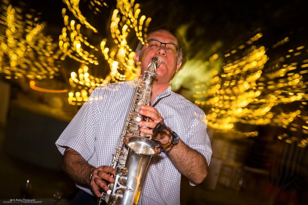 Wedding musician plays his Sax during the wedding reception. Photo by North East wedding photographer Elliot Nichol.