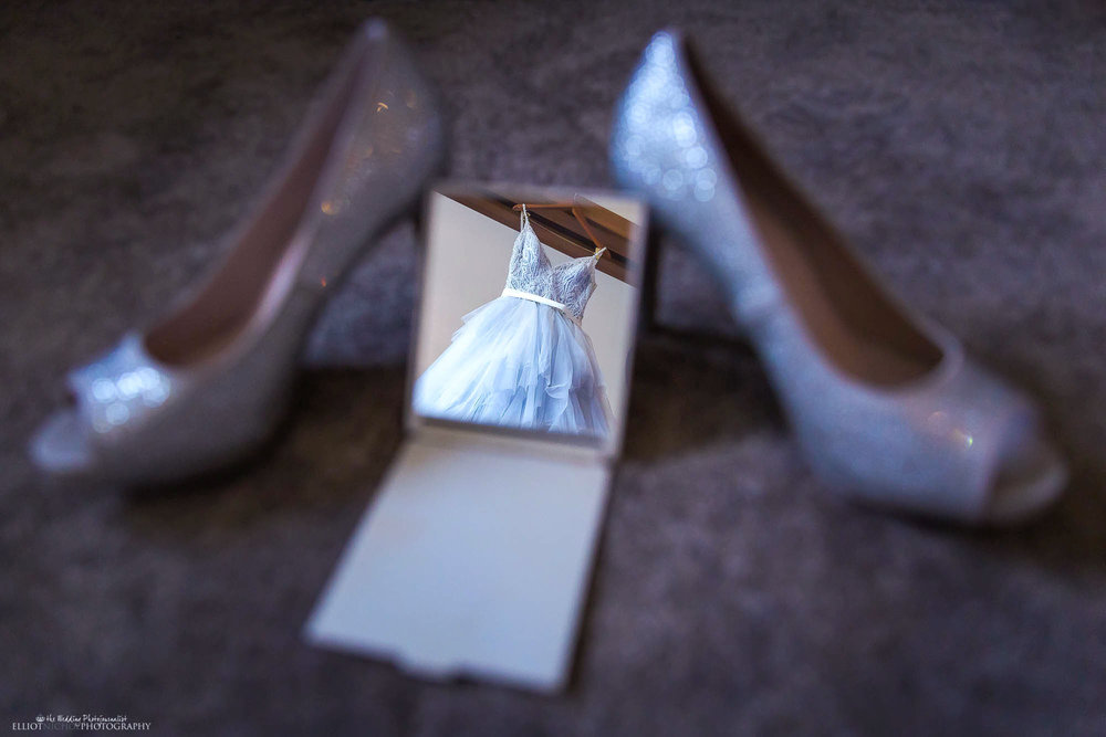 Brides blue wedding dress reflected in a hand mirror. Creative wedding photography by North East wedding photographer Elliot Nichol.