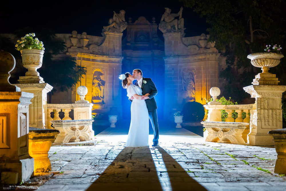Night time portrait of the bride and groom in the gardens of their wedding reception venue. Photography by wedding photographer Elliot Nichol.