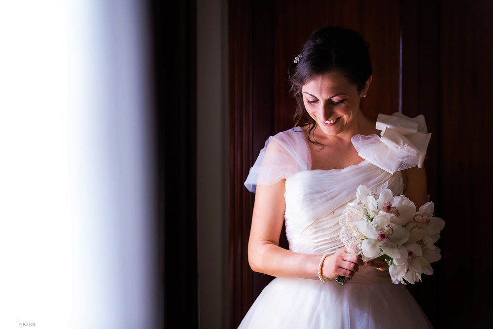 Bride takes a minute to compose herself before heading to her church wedding ceremony. Photo by Elliot Nichol Photography. Capturing weddings across the UK and European destinations.