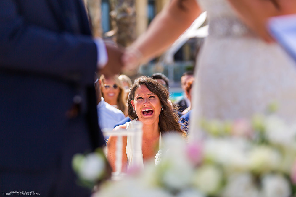 Brides best friend and chef bridesmaid becomes emotional during the outdoor civil ceremony. Photo by North East photographer Elliot Nichol.