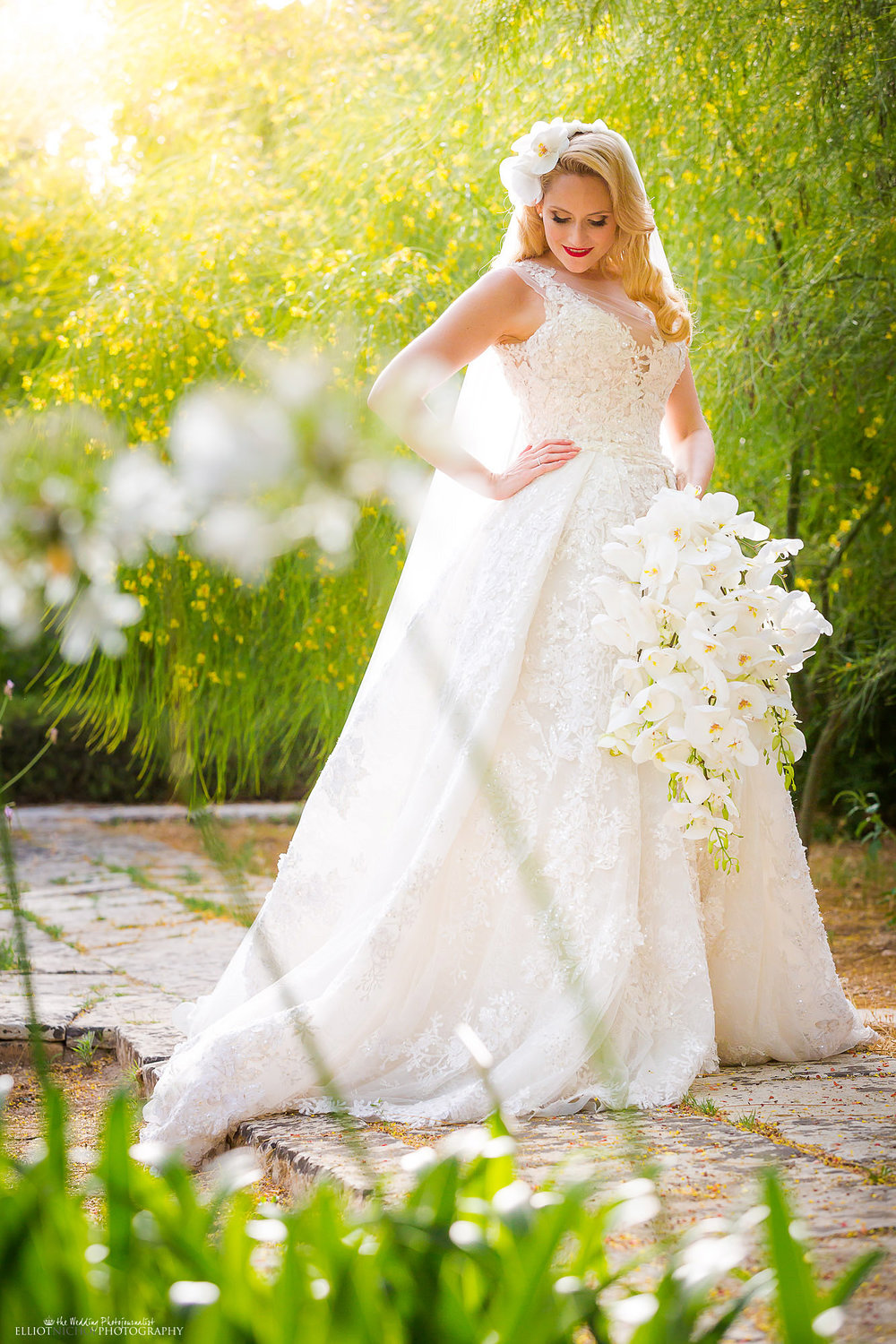 Bride within the grounds of her garden wedding venue. Photo by Elliot Nichol Photography. www.elliotnicholphoto.com