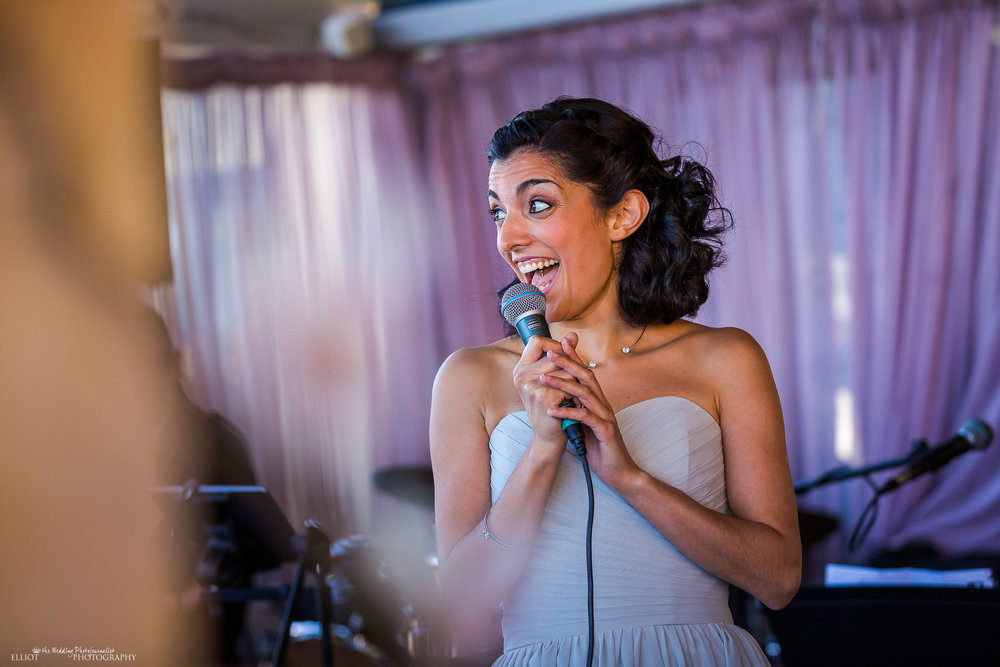 Bridesmaid having some fun during her wedding reception speech. Photo by Elliot Nichol Photography
