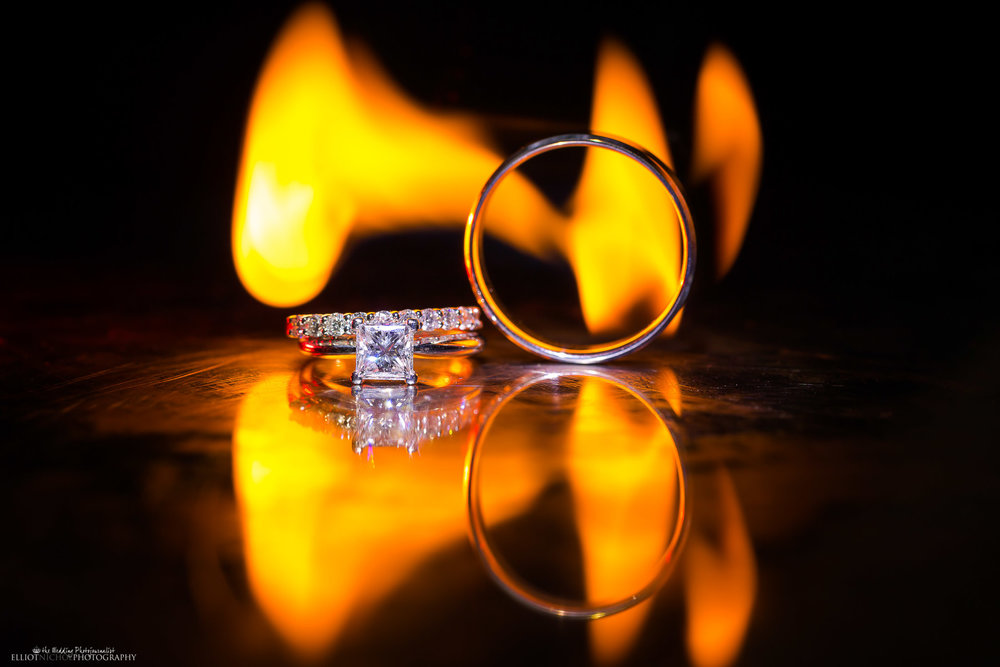 Wedding rings detail shot with fire. Creative wedding photography by Elliot Nichol Photography.
