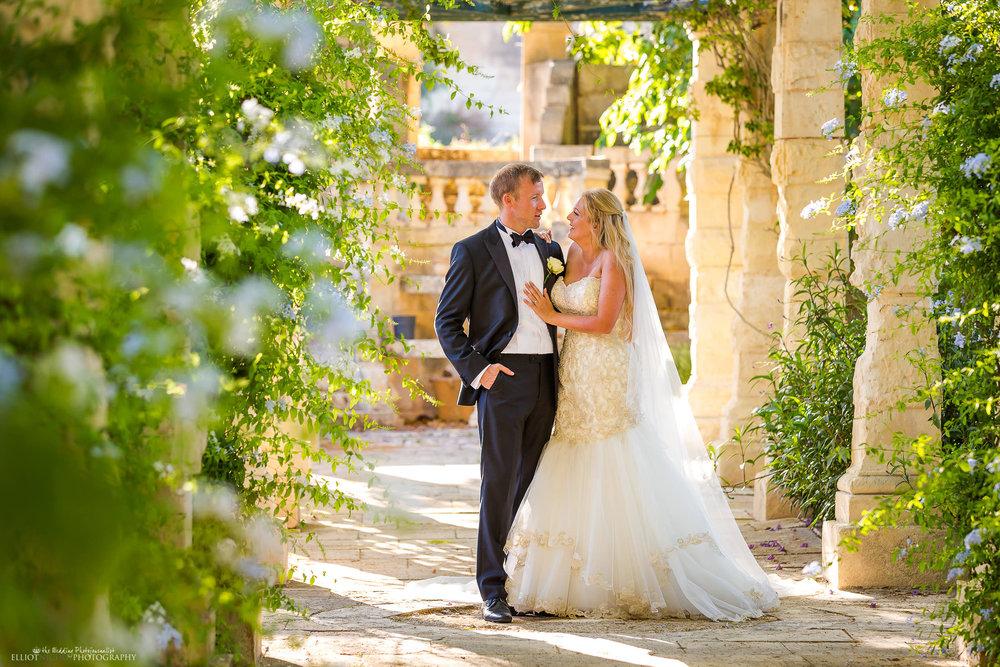 Bride and groom enjoying the garden of their wedding venue. Photo by Elliot Nichol.