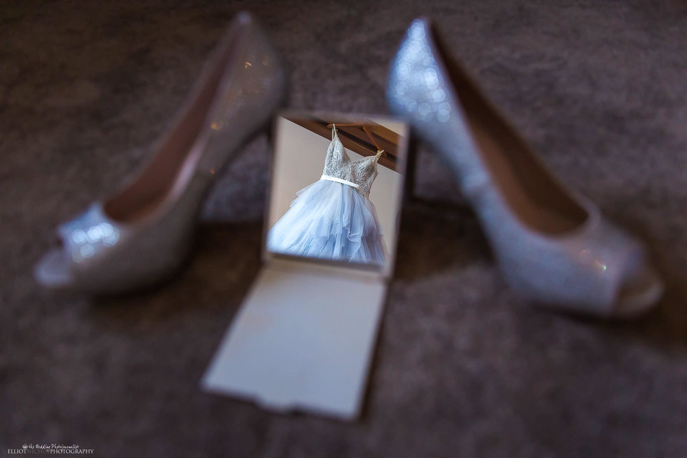 Brides wedding dress reflected in a small hand mirror. Photo by Elliot Nichol Photography.