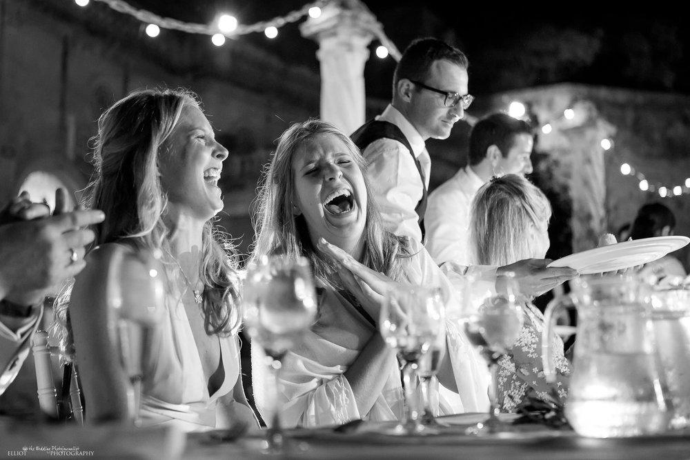 Wedding guests enjoying the wedding reception speeches. Photo by Elliot Nichol Photography.