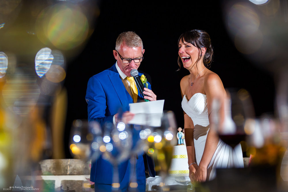 Bride laughing at her Grooms comments during his wedding speech. Photo by Elliot Nichol Photography.