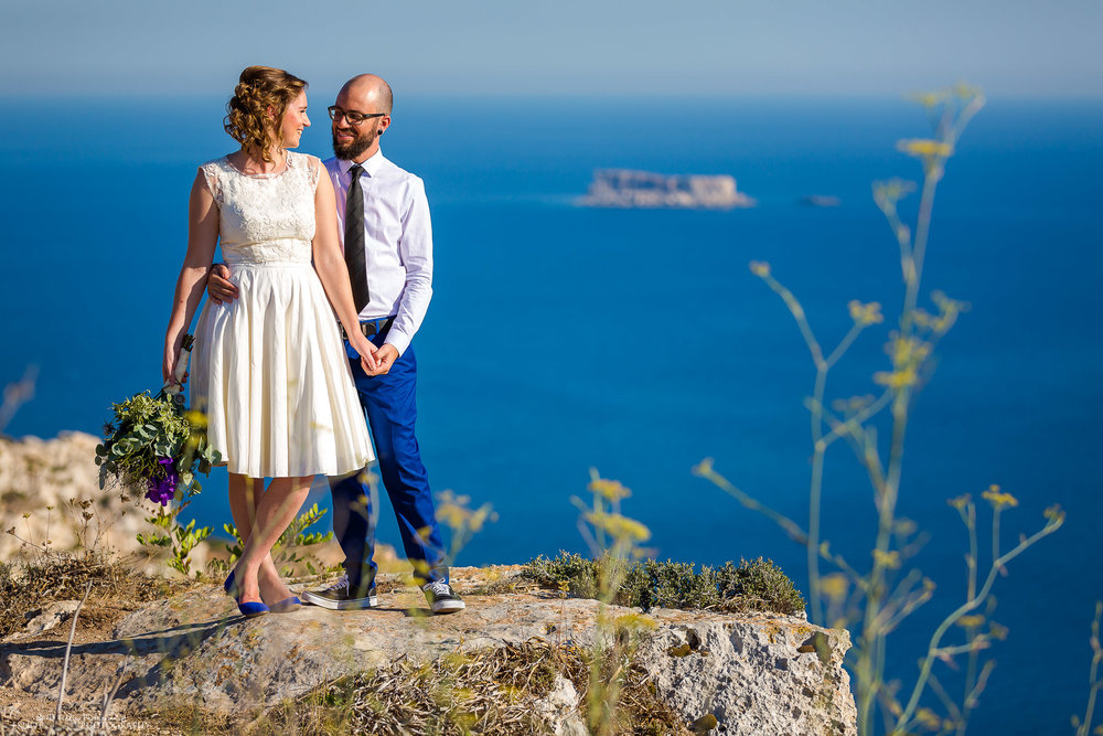Cliff edge wedding. Bride and groom take some time out. Photo by Elliot Nichol Photography.