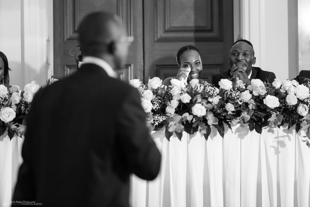 Bride bought to tears during her fathers wedding reception speech. Photo by Wedding Photojournalist Elliot Nichol.