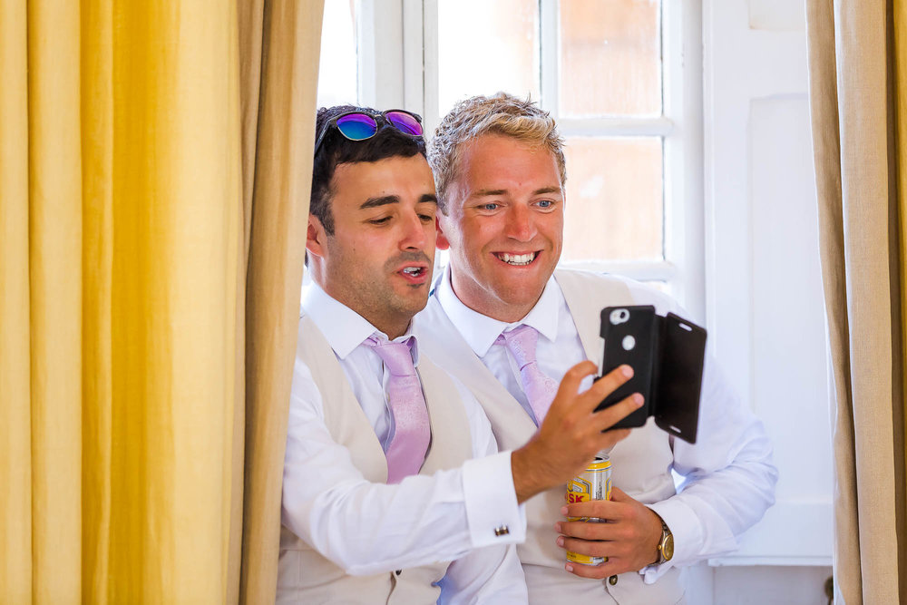 Groomsmen take a quick selfie. Photo by Elliot Nichol Photography.