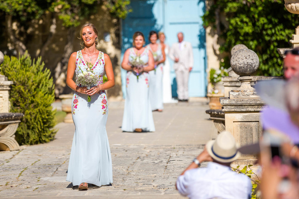 Wedding procession in the gardens of Villa Bologna in Malta. Destination wedding photographer Elliot Nichol.