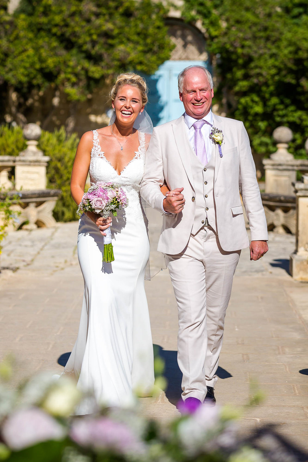 Happy bride and her father arrive at the garden civil ceremony. Photo by Elliot Nichol Photography.
