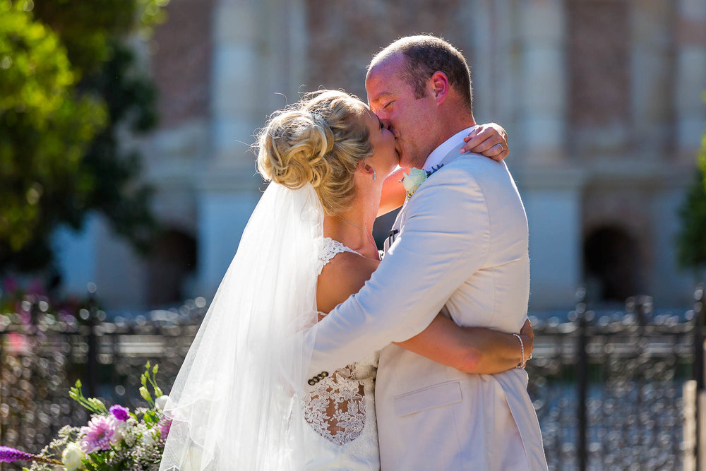 The newlyweds kiss after the wedding ceremony. Photo by Elliot Nichol Photography.