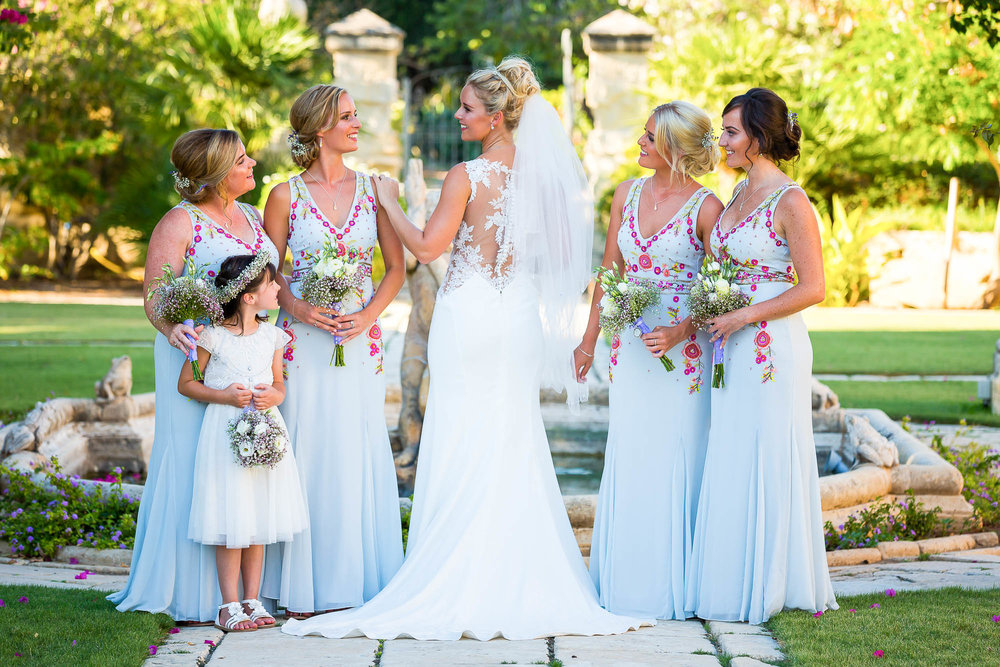 Bride with her bridesmaids and flower girl. Photo by Elliot Nichol Photography.