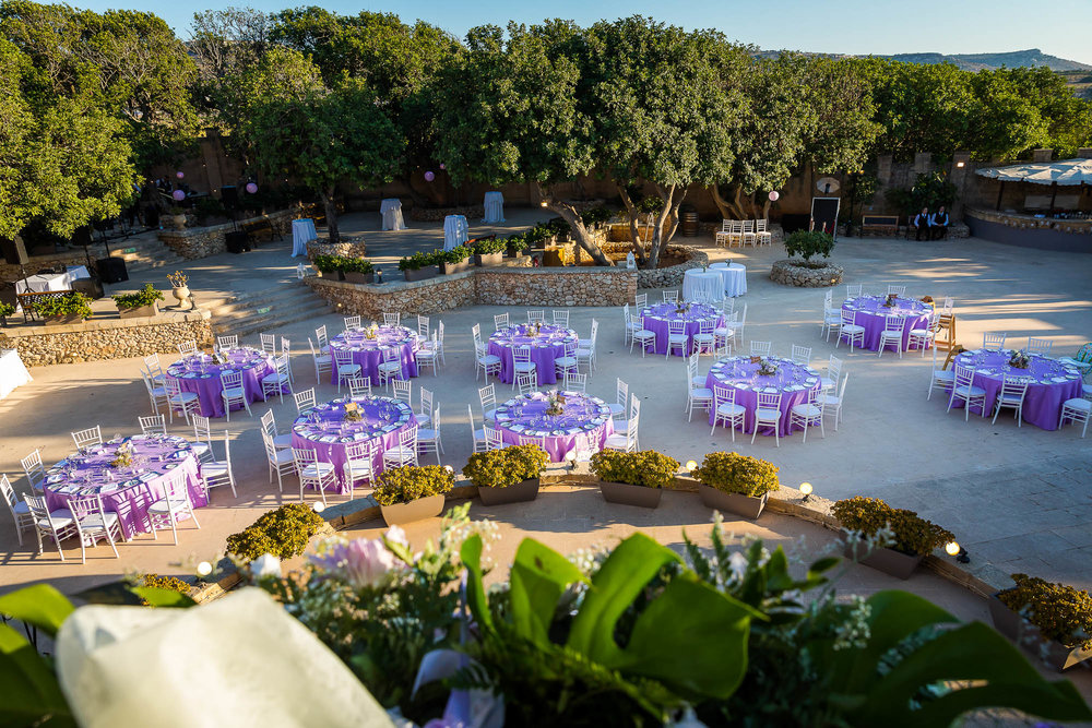 Destination wedding reception setup at the Castello Zammitello in Malta. Photo by Elliot Nichol Photography.