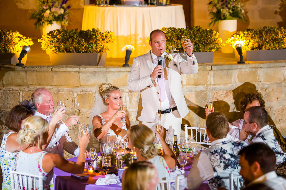 Groom performs a toast during his wedding speech. Photo by Elliot Nichol Photography.