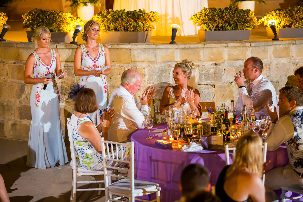 Bridesmaid perform their wedding reception speech. Photo by Elliot Nichol Photography