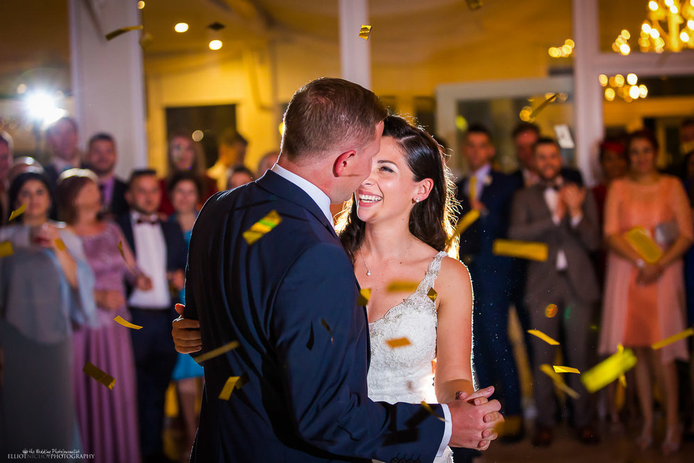 Newlyweds take their first dance together. Photo by Elliot Nichol Photography.