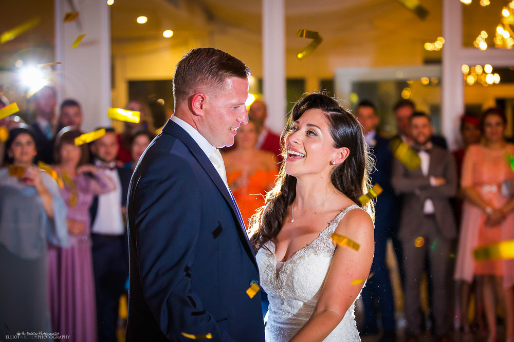 Bride and groom take their first dance together as husband and wife. Photo by Elliot Nichol Photography.