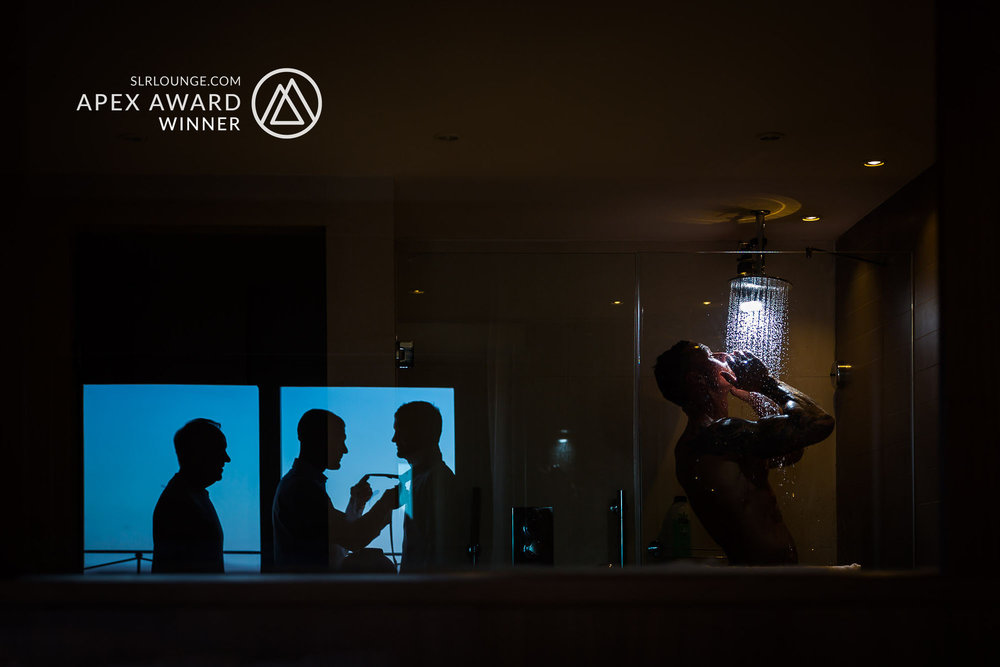 SLR Lounge's Apex Award winning image. Groom takes his shower while his groomsmen get ready for the bid event. Elliot Nichol Photography. www.elliotnicholphoto.com