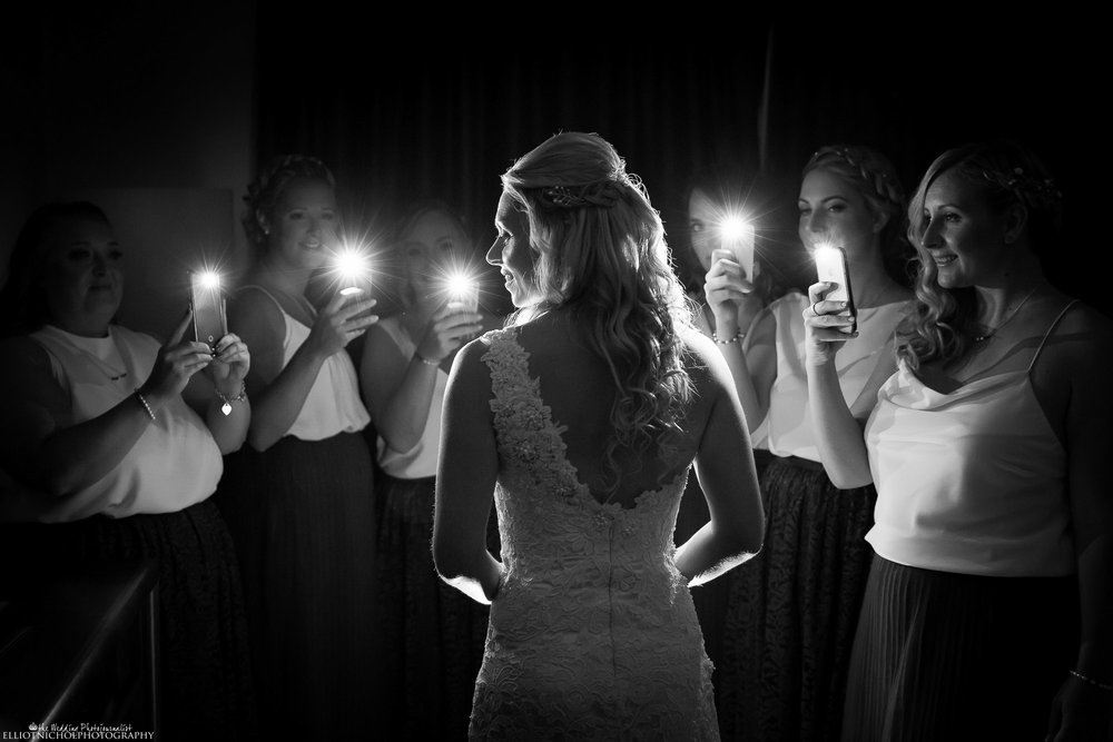 North East Bride light up by her bridesmaids using their mobile phone camera's. Photo by Northeast based wedding photographer Elliot Nichol Photography.