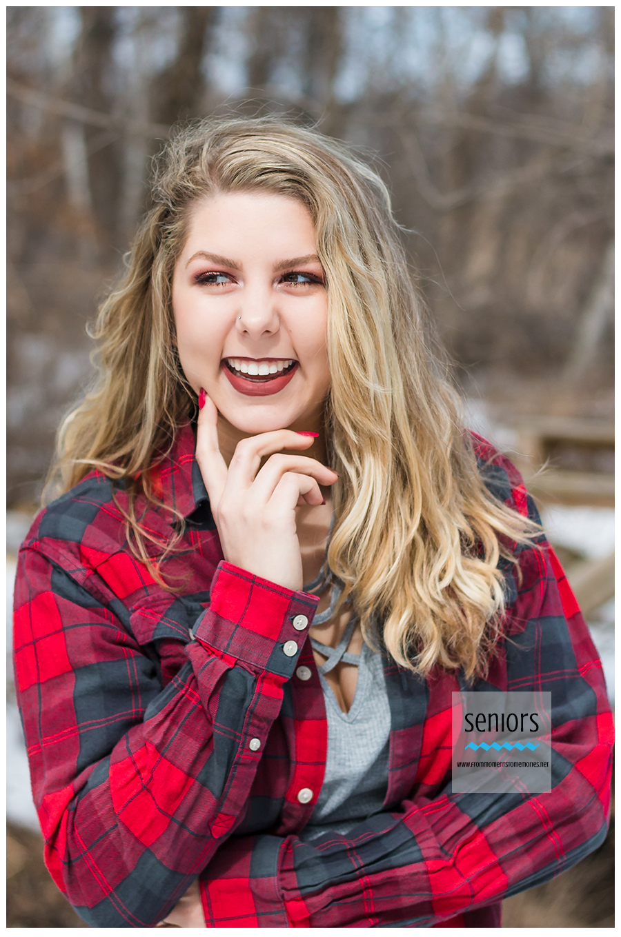 senior girl laughing and posing for winter senior pictures in elk river minnesota