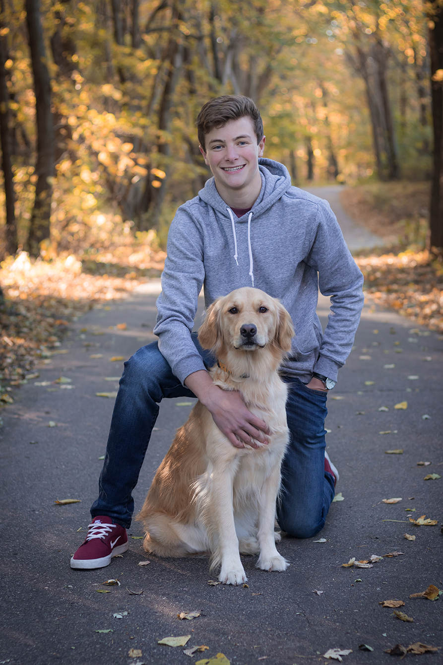 Senior boy photo with dog in Otsego, Minnesota in the fall