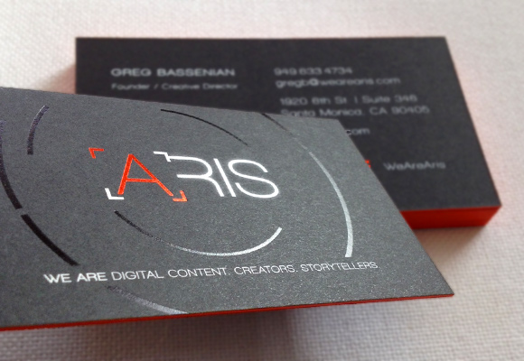 Black, orange, and white foil-stamped business card for Aris. By Akula Kreative.