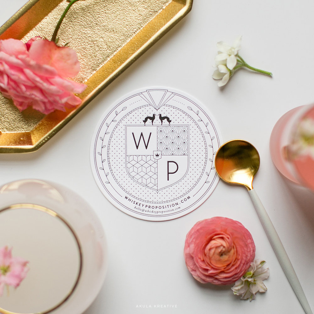 Custom Letterpress Coaster Business Card with Floral Flat Lay for Whiskey Proposition by Akula Kreative | 1920s inspired branding | akulakreative.com