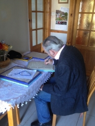 Robert Ballagh scribes lines in the porcelain book