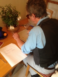 Mick O'Dea scribes in the porcelain book