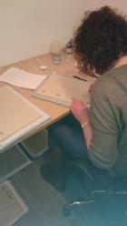 Denise Dunphy scribing lines from her story 'The Thread' in the porcelain book