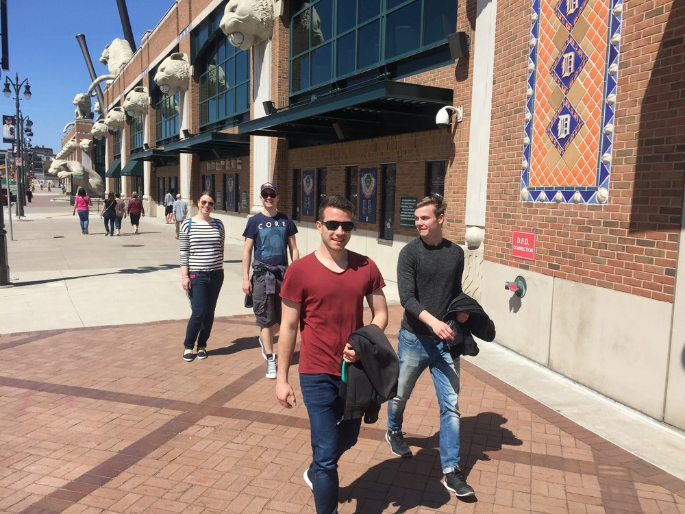 Four German student workers visiting Comerica Park.
