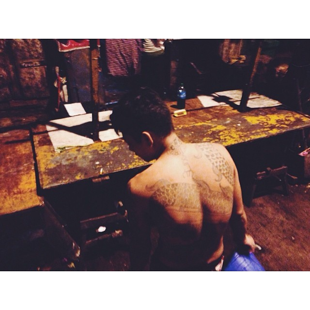 A man on the street in Yangon showing off his tattoos. #tattoo #yangon #myanmar #burma #street #latergram