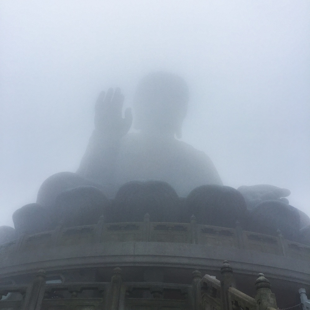 Tian Tan Buddha amongst the clouds and mist