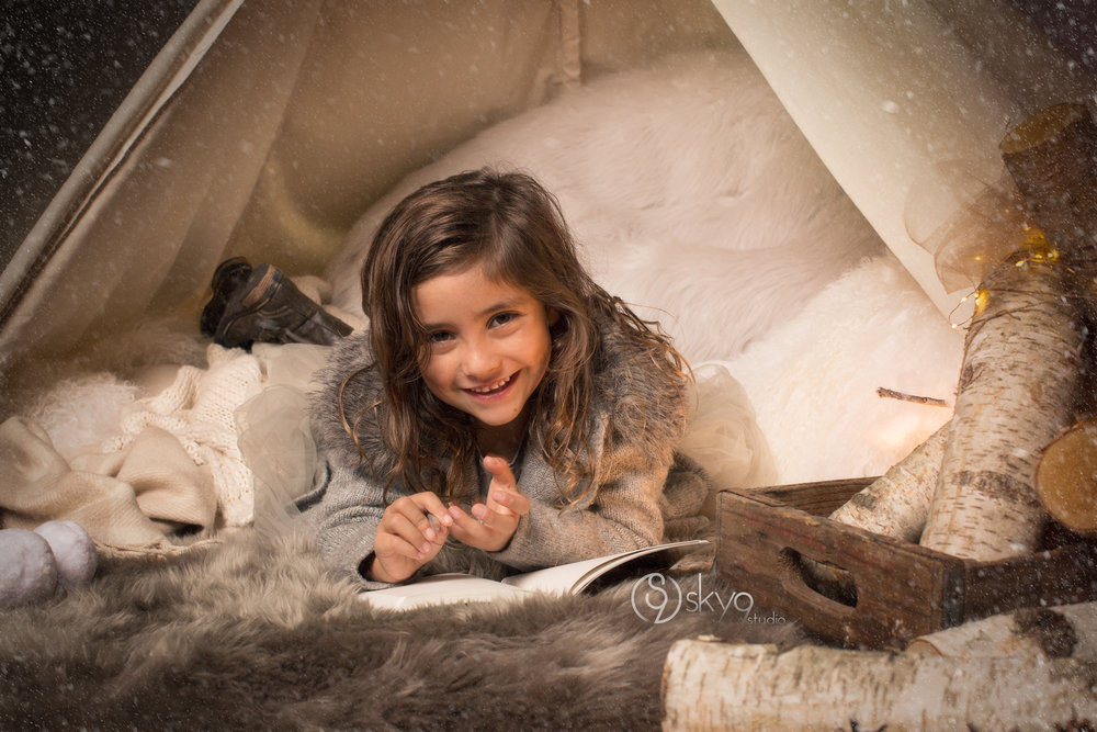 Restoration Hardware style winter mini-session with girl in tent reading a book.