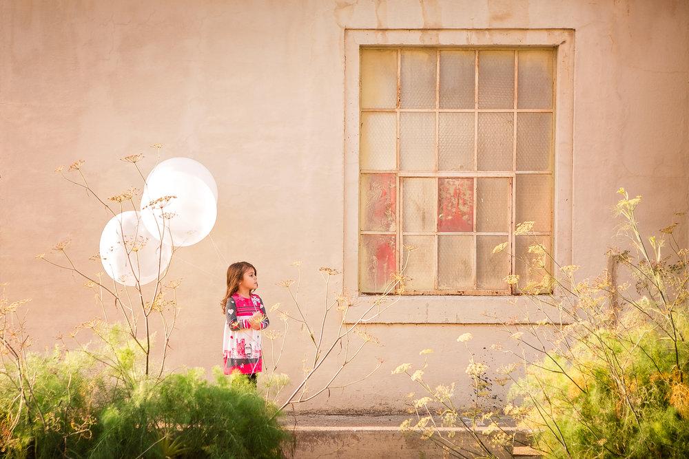 sky9studio-little-girl-white-balloons-benicia