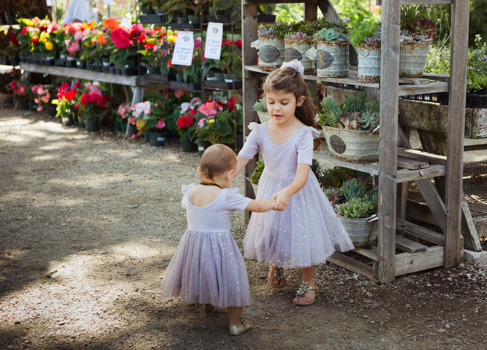 Sisters in matching Elestory lilac ballerina dresses