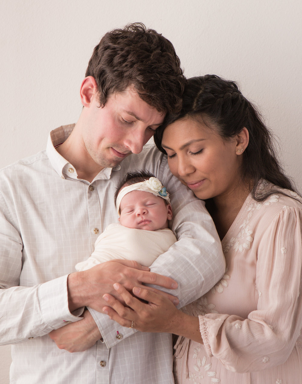 simple neutral family professional photo with newborn
