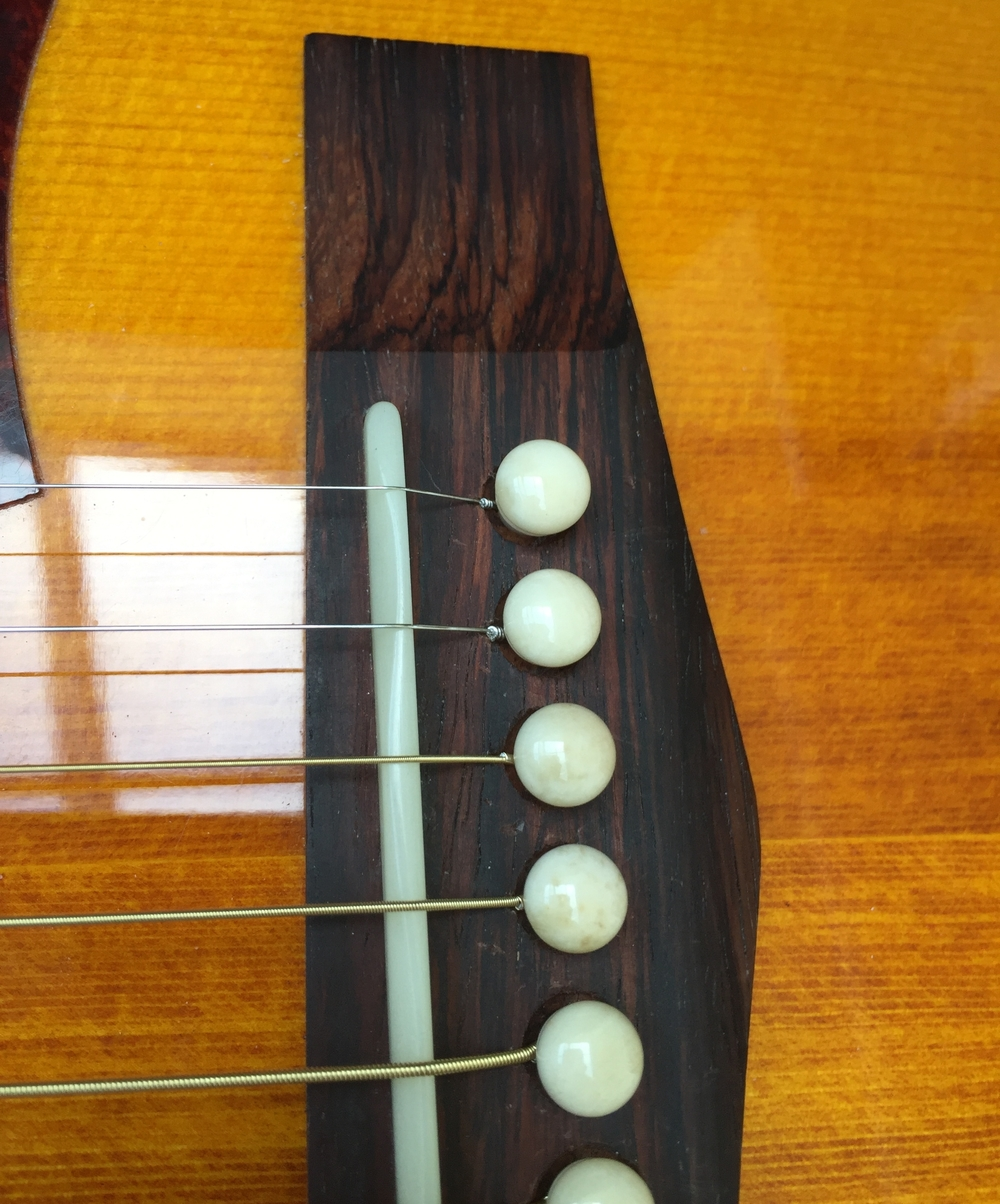 New bone saddle and bridge pins on an acoustic can have a dramatic effect on tone.