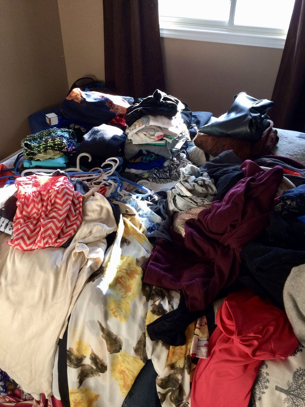 Throw everything onto the bed and go through every item. Behold, the dreaded 'Maybe Pile'!